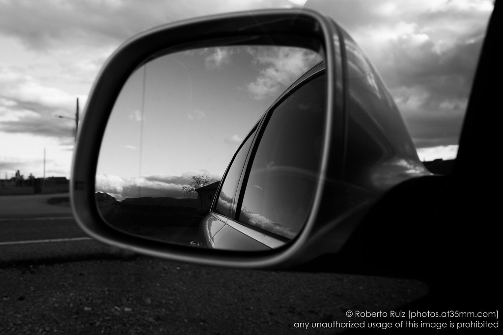 objects in the rear view mirror may appear closer than they are